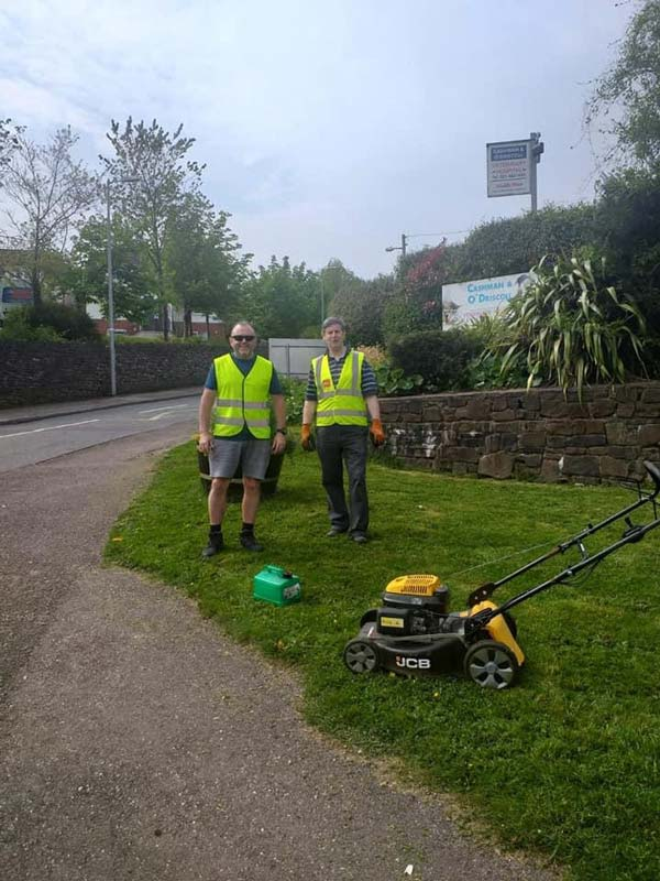Helping cut grass in Glanmire